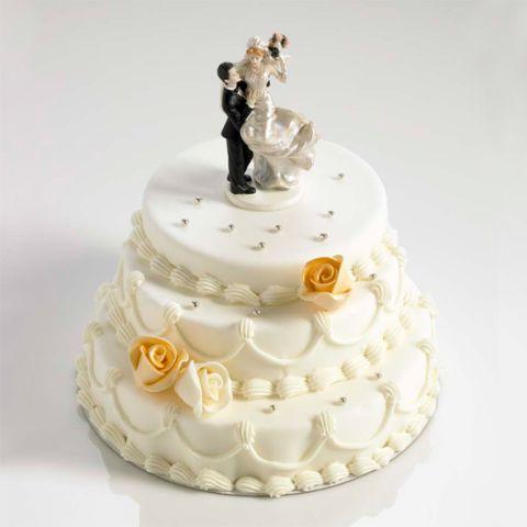 Huwelijkstaart met bruidspaar in kunsthars